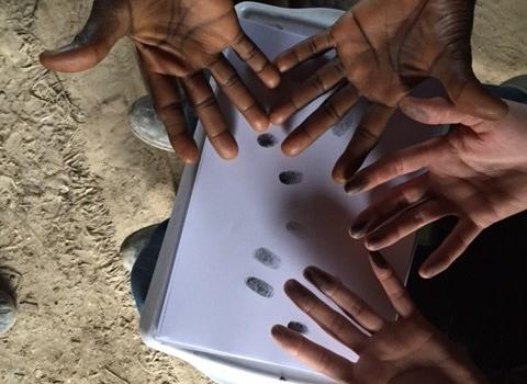 Migrants collecting fingerprints in Calais